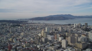 DFKSF06_049 - 5K stock footage aerial video pan across Nob Hill and Russian Hill office and apartment buildings, San Francisco, California