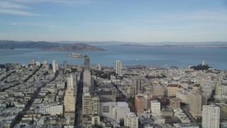 DFKSF06_050 - 5K stock footage aerial video pan across Nob Hill, Russian Hill apartment and office buildings to reveal Coit Tower, North Beach, San Francisco, California