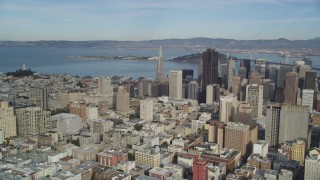 DFKSF06_051 - 5K stock footage aerial video pan from Coit Tower in North Beach to reveal skyscrapers in Downtown San Francisco, California