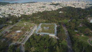 DFKSF06_057 - 5K stock footage aerial video of orbiting the California Academy of Sciences in iconic Golden Gate Park, San Francisco, California