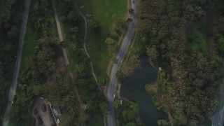 DFKSF06_066 - 5K stock footage aerial video of a bird's eye view of a road, lake and green lawns in iconic Golden Gate Park, San Francisco, California