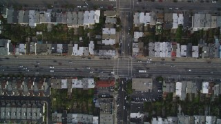 DFKSF06_069 - 5K stock footage aerial video of a bird's eye of row houses and streets in the Inner Sunset District, San Francisco, California