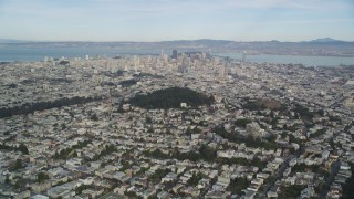 DFKSF06_074 - 5K stock footage aerial video of flying toward skyscrapers in downtown from Haight Ashbury, San Francisco, California