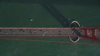 DFKSF06_088 - 5K stock footage aerial video bird's eye view of traffic crossing the iconic Golden Gate Bridge, San Francisco, California