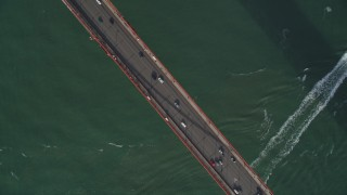 DFKSF06_089 - 5K stock footage aerial video bird's eye view of cars crossing the famous Golden Gate Bridge, San Francisco, California