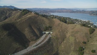 DFKSF06_093 - 5K stock footage aerial video approach freeway and Robin Williams Tunnel (formerly  the Waldo Tunnel), Marin, California