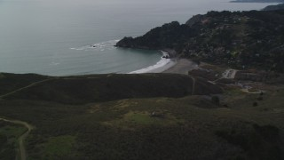 DFKSF06_102 - 5K stock footage aerial video of panning across hills to reveal Muir Beach, Marin County, California