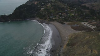DFKSF06_103 - 5K stock footage aerial video of flying by Muir Beach and hillside home on the coast, Marin County,  California