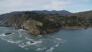 DFKSF06_104 - 5K stock footage aerial video of flying by hillside homes on coastal cliffs in Muir Beach, Marin County, California