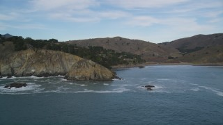 DFKSF06_105 - 5K stock footage aerial video of flying by coastal cliffs in Muir Beach, Marin County,  California