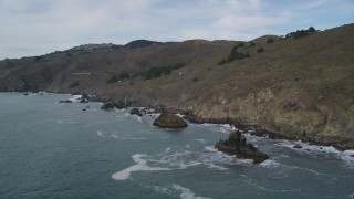 DFKSF06_106 - 5K stock footage aerial video of flying by the Muir Beach coastline, Marin County, California