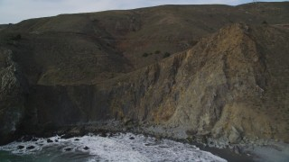 DFKSF06_107 - 5K stock footage aerial video approach and ascend over Muir Beach coastal cliffs, Marin County, California