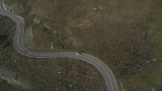 DFKSF06_110 - 5K stock footage aerial video track silver convertible on Highway 1, Marin County, California