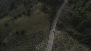 DFKSF06_112 - 5K stock footage aerial video of tracking a silver convertible traveling on Highway 1, Marin County, California