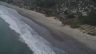 DFKSF06_114 - 5K stock footage aerial video of flying by beachside homes, Stinson Beach, California