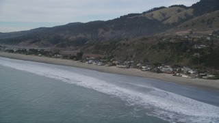 DFKSF06_115 - 5K stock footage aerial video of flying by beachfront homes and coastal hills, Stinson Beach, California