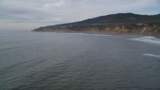DFKSF06_124 - 5K stock footage aerial video of flying over calm ocean near coastal cliffs, Bolinas, California