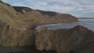 DFKSF06_133 - 5K stock footage aerial video of panning across coastal cliffs toward the ocean, Bolinas, California