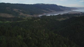 DFKSF06_139 - 5K stock footage aerial video approach Bolinas Lagoon from forest and mountains, Point Reyes National Seashore, Olema, California