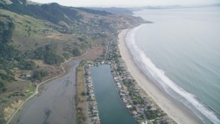 DFKSF06_147 - 5K stock footage aerial video of flying over marshlands near Lagoon, tilt to reveal beachfront homes, Bolinas, California