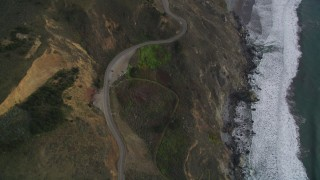 DFKSF06_149 - 5K aerial stock footage video of following Highway 1 coastal road winding above cliffs, Marin County, California