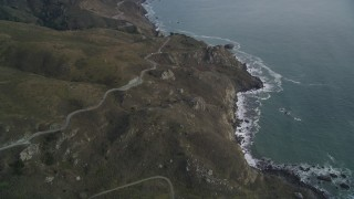 DFKSF06_150 - 5K stock footage aerial video of flying over the Highway 1 coastal road winding above cliffs, Marin County, California