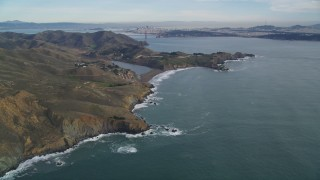 DFKSF06_154 - 5K stock footage aerial video of passing by Marin Headlands, San Francisco in the distance, Marin County, California