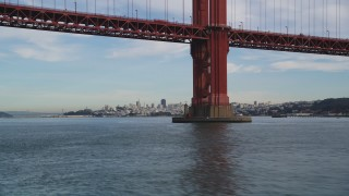 DFKSF06_163 - 5K stock footage aerial video fly under Golden Gate Bridge to approach Downtown San Francisco skyline, California