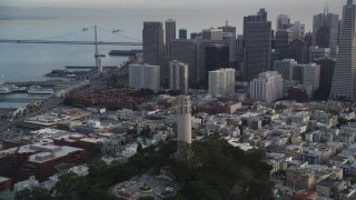 DFKSF06_170 - 5K stock footage aerial video flyby Coit Tower, revealing skyscrapers in Downtown San Francisco, California