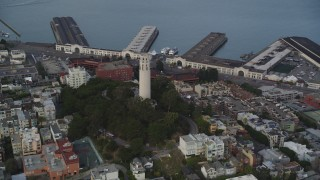 DFKSF06_175 - 5K stock footage aerial video tilt from North Beach apartments, reveal Coit Tower, San Francisco, California
