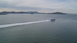 DFKSF06_177 - 5K stock footage aerial video of tracking a ferry cruising on the San Francisco Bay, California