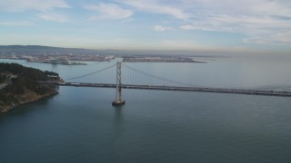 DFKSF06_181 - 5K stock footage aerial video of panning across the Bay Bridge, San Francisco, California