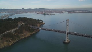 DFKSF06_182 - 5K stock footage aerial video approach the Bay Bridge and tilt to Yerba Buena Island, San Francisco, California