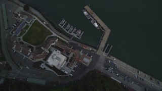 DFKSF06_183 - 5K stock footage aerial video fly over Yerba Buena Island, tilt to bird's eye of Coast Guard Station, San Francisco, California
