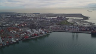 DFKSF06_186 - 5K stock footage aerial video of flying by the Port of Oakland, California