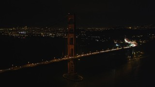 DFKSF07_038 - 5K stock footage aerial video of flying by the iconic Golden Gate Bridge, San Francisco, California, night