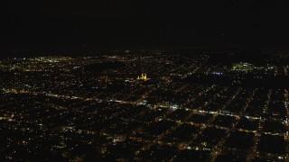 DFKSF07_043 - 5K stock footage aerial video approach St. Ignatius Church, Inner Richmond District, San Francisco, California, night