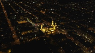 DFKSF07_044 - 5K stock footage aerial video tilt to reveal St. Ignatius Church in the Inner Richmond District, San Francisco, California, night