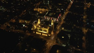 DFKSF07_045 - 5K stock footage aerial video orbit St. Ignatius Church in the Inner Richmond District, San Francisco, California, night