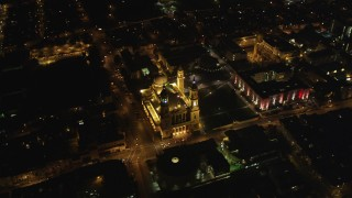 DFKSF07_046 - 5K stock footage aerial video orbit St. Ignatius Church in the Inner Richmond District, San Francisco, California, night