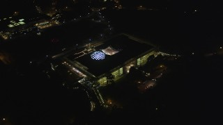 DFKSF07_047 - 5K stock footage aerial video orbit California Academy of Sciences museum in Golden Gate Park, San Francisco, California, night