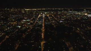 DFKSF07_050 - 5K stock footage aerial video of following Fulton Street, tilt to reveal city hall, Western Addition, San Francisco, California, night