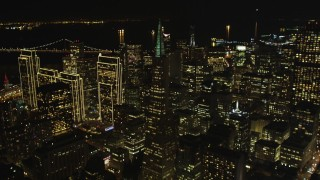 DFKSF07_059 - 5K stock footage aerial video of tilting from Columbus Ave to reveal skyscrapers in Downtown San Francisco, California, night