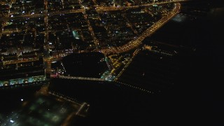 DFKSF07_066 - 5K stock footage aerial video of tilting from AT&T Park to reveal skyscrapers in Downtown San Francisco, California, night