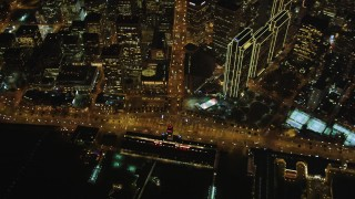 DFKSF07_070 - 5K stock footage aerial video of a bird's eye of Ferry Building, Embarcadero, Market St, Downtown San Francisco, night