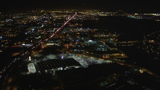 DFKSF07_088 - 5K stock footage aerial video of flying over I-880 freeway and warehouses, Oakland, California, night