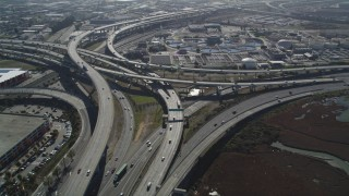 DFKSF08_003 - 5K stock footage aerial video of orbiting the MacArthur Maze freeway interchange, Oakland, California