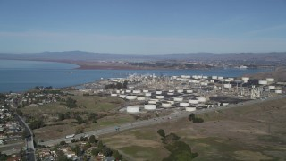 DFKSF08_022 - 5K stock footage aerial video of an approach to the ConocoPhillips Oil Refinery, Rodeo, California