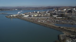 DFKSF08_024 - 5K stock footage aerial video of flying by ConocoPhillips Oil Refinery, seen from San Pablo Bay, Rodeo, California