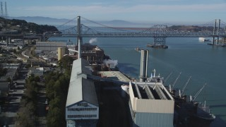 DFKSF08_039 - 5K stock footage aerial video of flying over C&H Pure Cane Sugar Factory to approach Carquinez Bridge, Crockett, California
